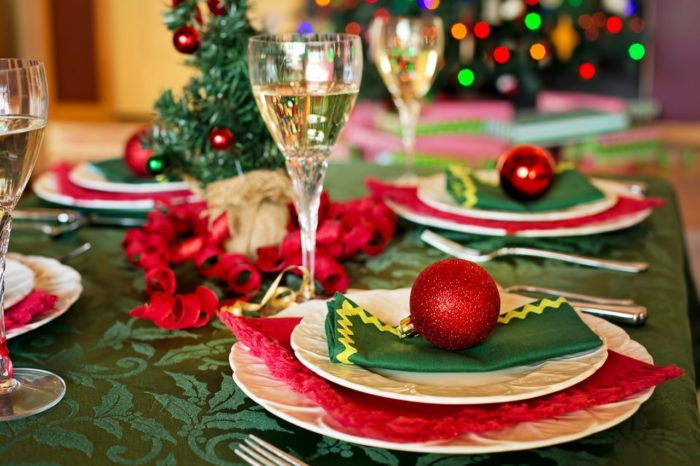 Christmas table decorations, plate settings and champagne glasses