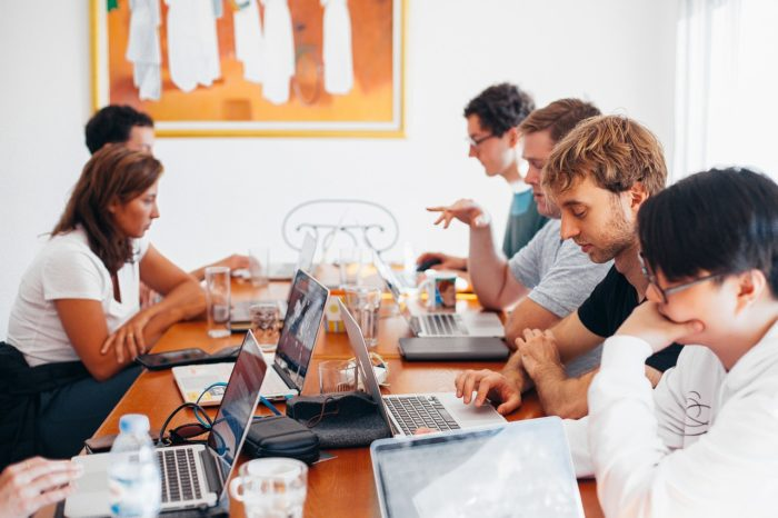 Several Business Professionals Working on Computers & Writing